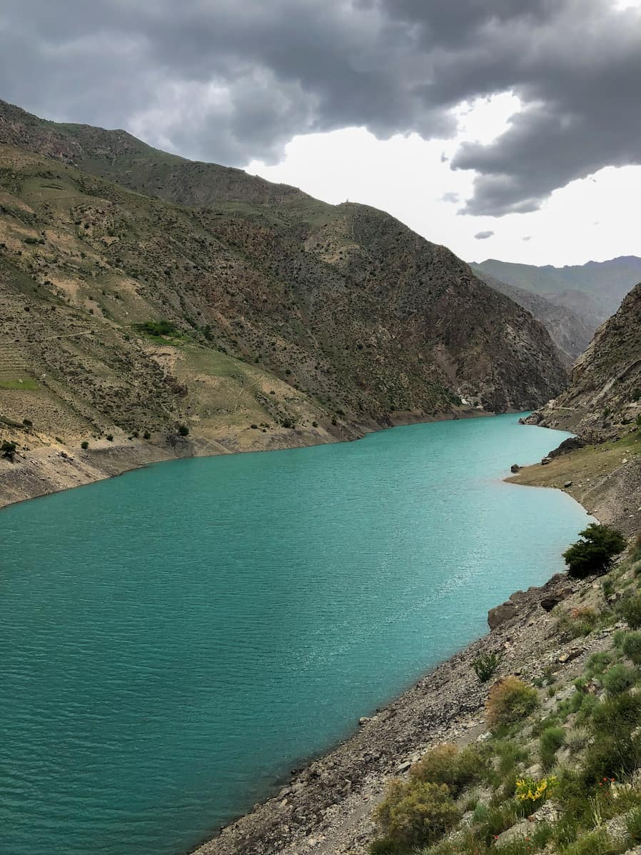 Beautiful emerald lake in Tajikistan with dramatic skies