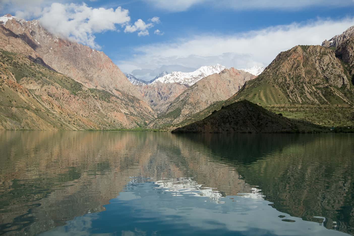 Iskanderkul Lake surrounded by mountains in Tajikistan