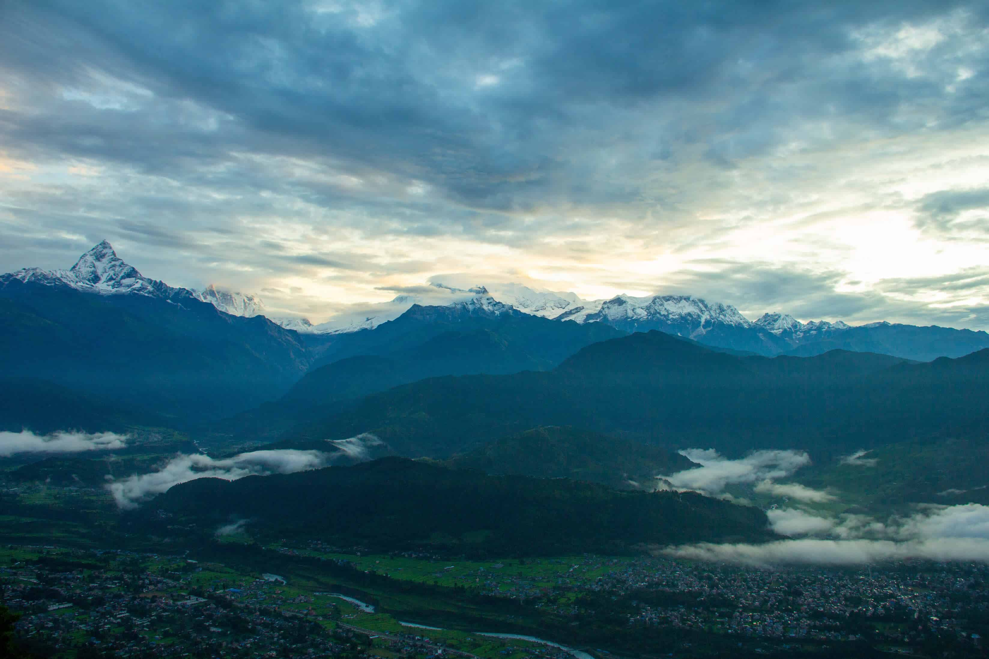 Snow-cupped mountains as backdrop of Pokhara city below