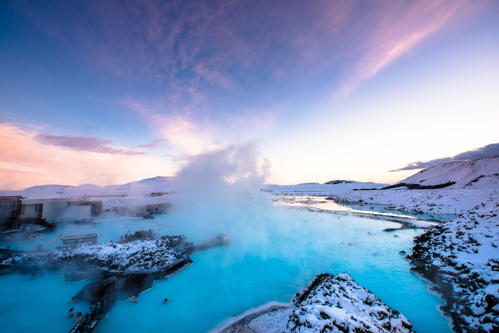 Birds eye view of Iceland's Blue Lagoon with mist mingling with sunset skies